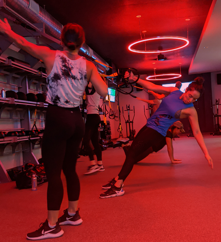 woman doing exercise using trx suspension trainer